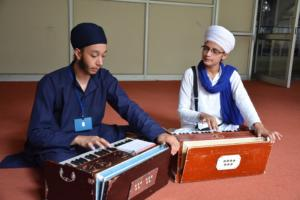 Student learm Kirtan in at Akal International youth camp (7)