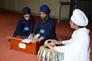 Student learm Kirtan in at Akal International youth camp (8)
