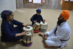 Student learm Kirtan in at Akal International youth camp (9)